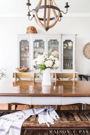 A French Country Dining Room Embodies Rustic Elegance With Neutrals Wood Tones And Peony Centerpiece