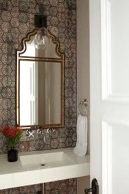 moroccan style powder room with brown mosaic tiles mediterranean