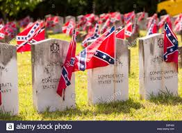memorial day graveside decorations confederate rebel flags decorate grave markers of soldiers killed