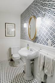 Bathroom Vanity Lighting Ideas And Design Tips | Apartment Therapy Bathroom Picture Ideas Awesome Master With Hardwood Vanity Lighting And Design Tips Apartment Therapy Menards Wattage Lights Fixtures Lowes Nickel Lamp Home Designs Bronze Light Mirrors White Double Delightful Two For And Black Wall Modern Model Example In Germany Salt Lamps Photos Houzz Satin Rustic Style Exquisite Fixture Your House Decor
