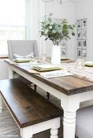 A Coastal Farmhouse Dining Room With Big Wood And White Table Gray Walls