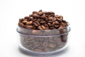 Transparent Cup With Coffee Beans On Isolated Background Stock Photo