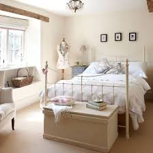 A Soft Cream Backdrop Ornate Metal Bedstead And Collection Of Pretty Accessories Create