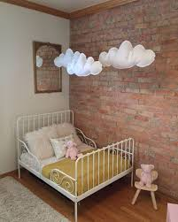 Exposed Brick Wall And Felt Clouds To Soften The Look
