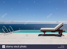 Infinity Pool And Lounge Chair Overlooking Ocean Stock Photo ... Ethimo Finity Lounge Armchair Tattahome Infinity Chaise Lounge Mondo Contract Zero Gravity Chair Parts Buy Partsinfinity Chairzero Product On Alibacom Woman Looking At Sea Sitting Lounge Chair By Finity Design Exllence Design Caravan Sports Oversized Beige Metal Patio Review Ethimo Armchair I Casa Group Black 2pack Lc525im