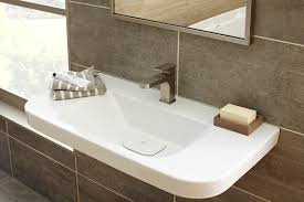 Trough Bathroom Sink With Two Faucets Canada by American Standard Press Dxv Luxury Portfolio Expands With