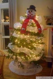 Creative Christmas Tree Decorating With White Ribbons And Snowman Top