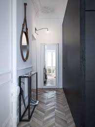 Long Hallway With Wall Mirror And Herringbone Floors Also Black Accent Awesome Decorating