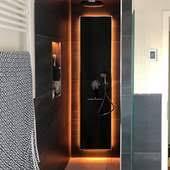 modernes badezimmer mit led beleuchtung und elektroheizung