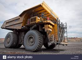 100 Large Dump Trucks Dump Truck Driving On The Floor Of A Copper Mine