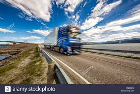 100 Atlantic Trucking Truck Rushes Down The Highway In The Background