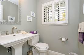 Kohler Memoirs Pedestal Sink by Traditional Powder Room With Limestone Tile Floors U0026 High Ceiling