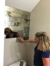antique mirror backsplash installed in different tile sizes the