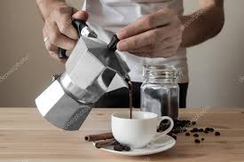 Pouring Coffee Out Of Italian Pot Stock Photo