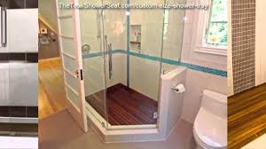 Enchanting Bathroom With Wood Flooring And Shower Also Teak Mat Window Treatment