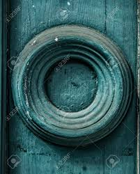 Round Element Of The Old Wooden Walls Painted In Dark Turquoise Color Background Stock Photo