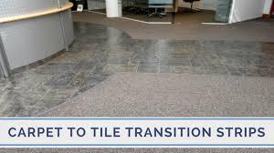 Carpet To Tile Transition Strip On Concrete by Clip Top Transition Strips Vs Nap Trim For Carpet To Tile Transitions