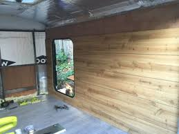 Hookhands Began Installing Faux Wood Paneling On The Walls Of Camper