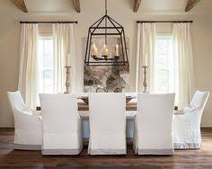 Beautiful Dining Room Slipcovered Chairs Farm Table Oversized Chandelier Neutral Colors LOVE