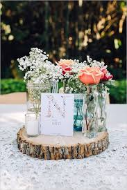 Rustic Babys Breath And Roses In Lace Covered Mason Jar Wedding Centerpiece