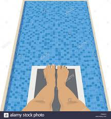 Feet On A Diving Board Above Swimming Pool