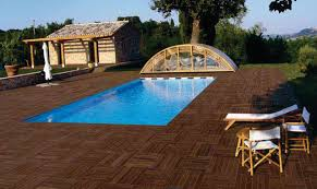 porcelain pavers around pool with teknowood simulated wood