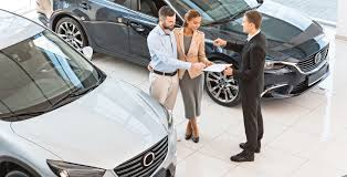 Related 20 Cheapskate Secrets to Buying a New Car couple signing new car lease