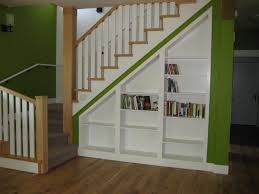 InteriorUnusual White Bookshelves Under Wooden Staircase With Green Wall Paint And Flooring