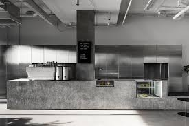 The Walls Are Clad In A Veil Of Perforated Aluminium That Folds Itself Across Creases Screening Kitchen And Smaller Private Dining