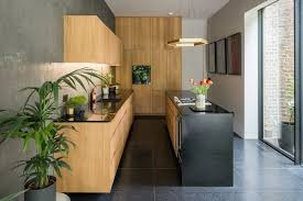 The Kitchen Pairs Bespoke Oak Cabinetry With Gaggenau Appliances And Black Corian Worktops That Feature Brass