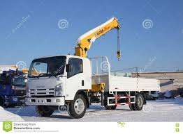 Great White Auto Truck Crane Standing On Construction Site In Winter ...