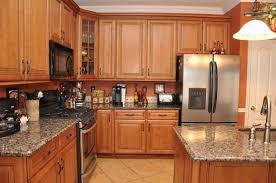 Honey Oak Cabinets With Orange Wall