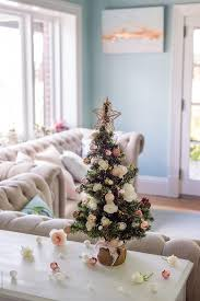 Small Xmas Tree With Roses And Copper Accessories By Gillian Vann For Stocksy United