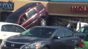 SUV Driver Enters Tug Of War With Tow Truck