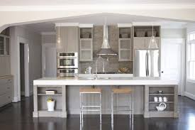 gripping gray kitchen island with glass pendant lighting