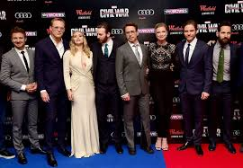 Chris Evans Gets Caught Gawking At Elizabeth Olsens Cleavage On The Red Carpet