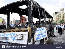 100 Burnt Truck Egyptians Gather Past A Burnt Truck At Tahrir Square In Cairo On