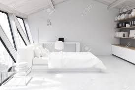 weißes schlafzimmer im dachgeschoss mit einer weißen holzdecke einem weißen boden und einer weißen und einer grauen wand einem großen fenster und