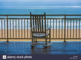 A Rocking Chair On A Terrace Overlooking The Beach Stock ... Wooden Puppet On The Wooden Beach Chair Blue Screen Background Outdoor Portable Cheap Rocking Chairpersonalized Beach Chairs Buy Chairpersonalized Chairsinflatable Chair Product Coastal House Art Blue Sharon Cummings Tshirt Miniature Of A In Front Lagoon Hot Item High Quality Telescope Casual Sun And Sand Folding Bluewhite Stripe Version Stock Image Image Coastal Print Cat In A On The Stock Tourist Trip Summer Travel White Alexei Safavieh Fox6702c Bay Rum Na Twitteru Theres Rocking