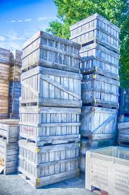 Download Stack Fruit Boxes Or Crates Sit Outside A Warehouse Stock Image