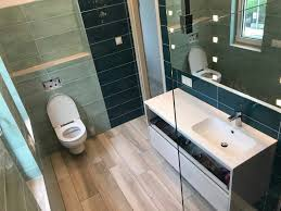 my modern bathroom with mint and petrol blue tiles with wood