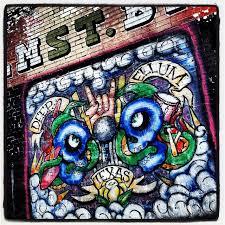 elm street bar mural grafitti brick wall deep ellum dallas texas
