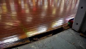 Hardwood Floor Buckled Water by Palatine Roller Rink Asking For Help After Storm Warps Floor