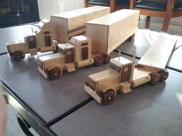 Handmade Wooden Toy Trucks, From Small World Peterbilt Play Set ... Diecast Trucks Wyatts Custom Farm Toys Trailers Amazoncom Mack Log Trailer Diecast Replica 132 Scale Assorted Hess Toy Classic Hagerty Articles With Campers Best Truck Resource Promotional Suppliers And Cheap Rc And Find Deals On Line Collectors Models Stobart Club Shop Pin By Farooq Big Rigs Pinterest Semi Trucks Rigs Hot Wheels Track Big W Moores