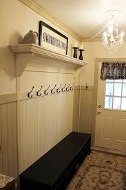 Mudroom bench and coat rack made to look built in Clever idea