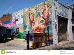 Deep Ellum Wall Murals by Graffiti On Brick Wall Of Restaurant Editorial Stock Image Image