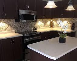 lighting cabinet puck lighting beautiful kitchen
