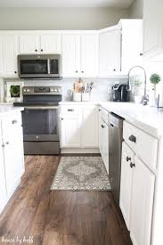 Snap Lock Flooring Kitchen by How Our Laminate Floors Are Holding Up Almost 2 Years Later