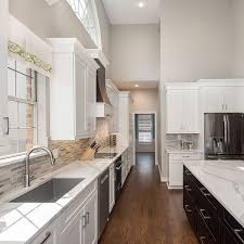 Small Horseshoe Shaped Kitchen With Oak Cabinets And