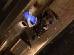 Pilot light on Gas Stove touches one of the tubes DoItYourself